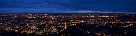 Munich center cityscape night panoramic aerial view. Skyline panorama captured from height of lookout viewing platform on tv-tower. Standard-Bild
