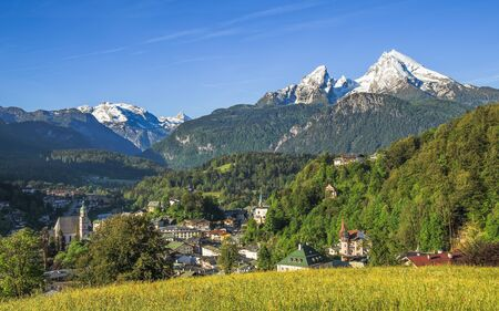 Panoramic landscape view of German small tourist town Berchtesgaden with snow-crowned Watzmann mount in Bavarian Alps