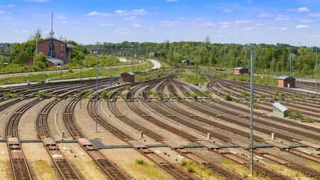 Freight railway yard with many tracks and operations control tower in north of Munich