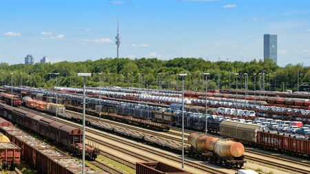 Munich, Germany - July 10, 2019: Panoramic view of Munich North rail classification yard with many many loaded wagons pending delivery