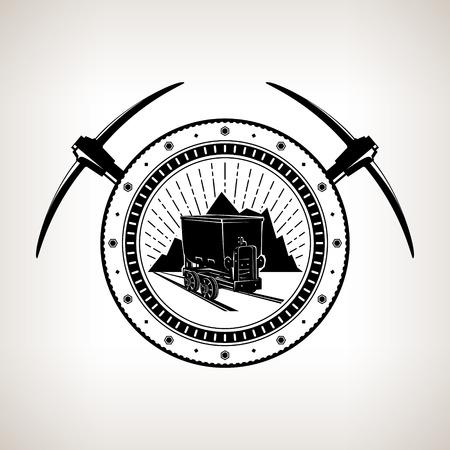 Emblema de la industria minera, la mina de carbón Trolley contra las montañas y Sunburst en un engranaje con dos picos cruzados, la etiqueta y la insignia Mine Shaft, ilustración vectorial Foto de archivo - 80914949