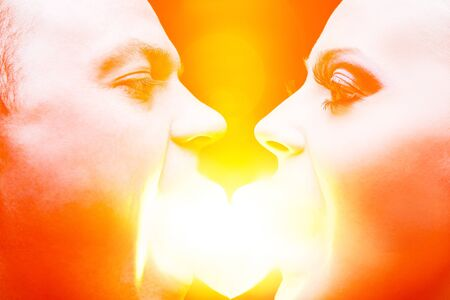 Creative portrait of couple eating heart of light and looking each other Stock Photo