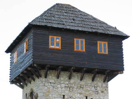 crenelation: Photo of medieval tower on the fortress above town of Doboj.