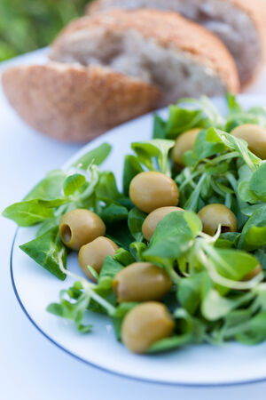 cornsalad: Olives and corn-salad with home-baked bread  Stock Photo