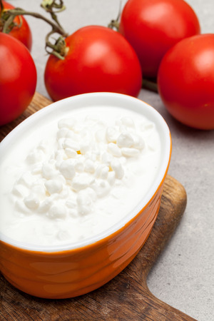 cottage cheese: Cottage cheese and tomatoes. Stock Photo