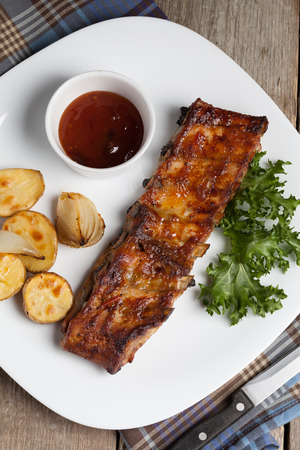 Barbecue pork ribs on a white plate. Stock Photo