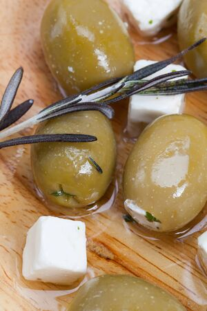 olive: Tapas, green olives stuffed with feta cheese.