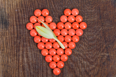 nutriment: Heart of vitamins, vital heart for Valentines Day on wooden background.