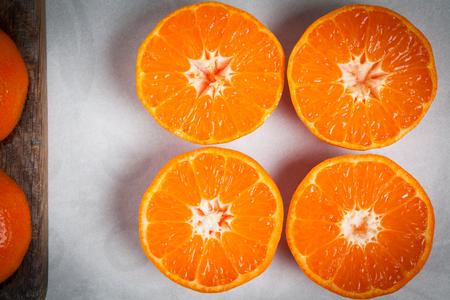 juicy: Halved juicy mandarins closeup.