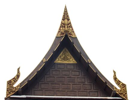 Very nice handicraft from North of Thailand, wooden sculpture painted  with gold color placed on triangular end of a roof  Stock Photo