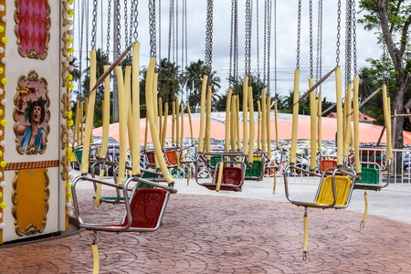 A large, Rotating machine with seats for people to ride in amusement park. Stock Photo - 20695794
