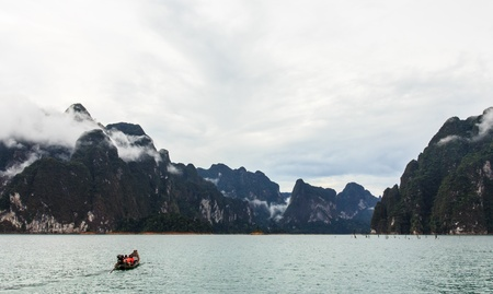 The small tail-machine boat bring group of tourist to another side of mountain, Khao Sok Suratthanee Thailand  photo