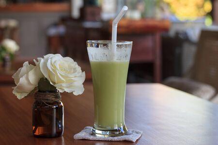 frozen drink: Frozen drink beside with light yellow rose.