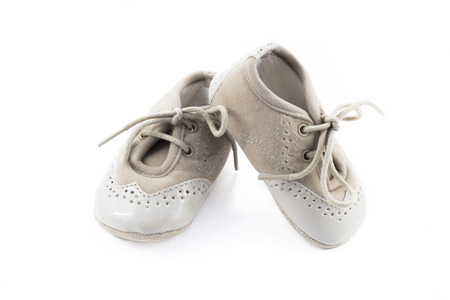 treading: Beige shoes for kids isolated on a white background