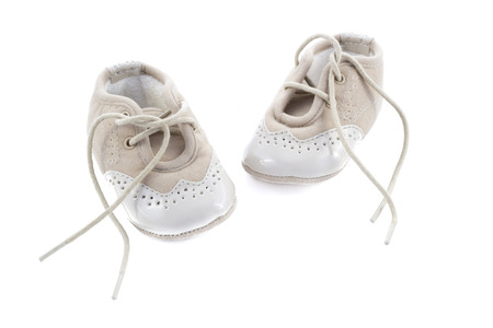 fashion  babies's wear: Beige shoes for kids isolated on a white background