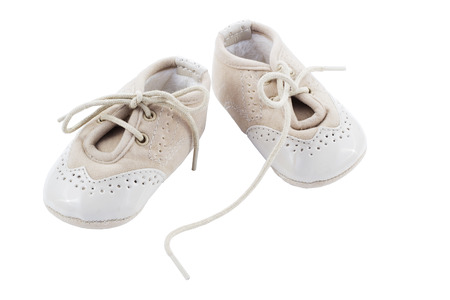 children s feet: Beige shoes for kids isolated on a white background