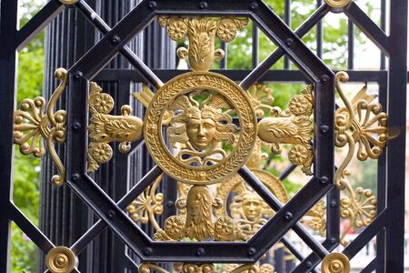 castings: gates with golden architectural element Stock Photo