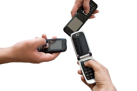three mobile phones in hands Stock Photo - 4553382
