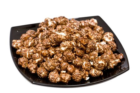 chocolate popcorn on the black plate isolated on white Stock Photo - 4553632