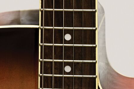 acoustic guitar on neutral background
