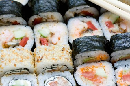 japenese: different types of traditional japanese rolls and stiicks close-up