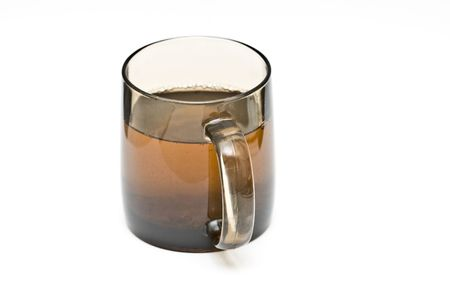 a transparent black cup with tea and tealeafs photo
