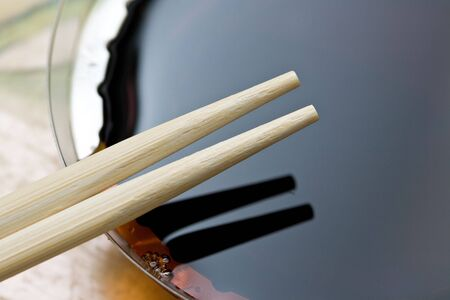 japanese traditional chopsticks close up on the background of the sause