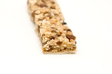 fitness bar with raisins on neutral background