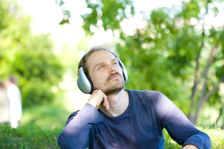 young man with headphones relaxing