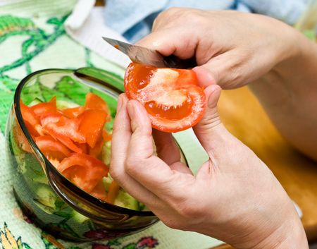 woman cutting vegetables close up