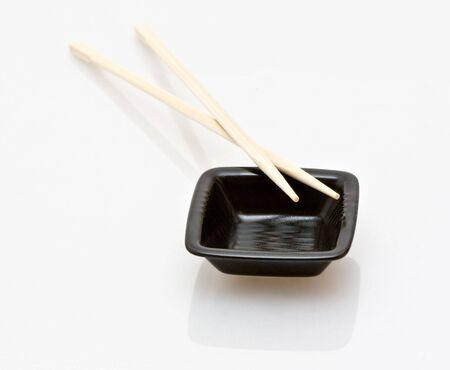 chopsticks and a wasabi dish