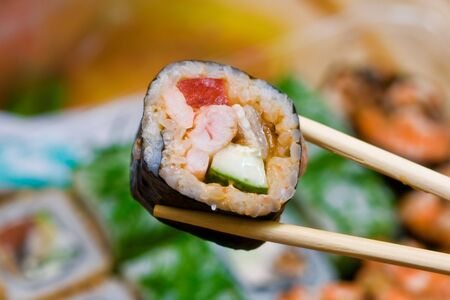 japanese rolls and chopsticks Stock Photo - 5128552