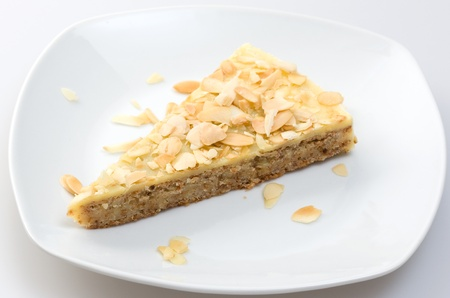 a piece of traditioanl almonf cake on a plate