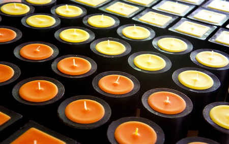 yellow and orange aroma candles