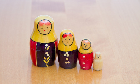 russian dolls on wooden table