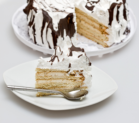 cake and piece of cake in a glass plate