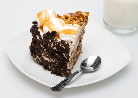 cake in a glass plate with a spoon Stock Photo