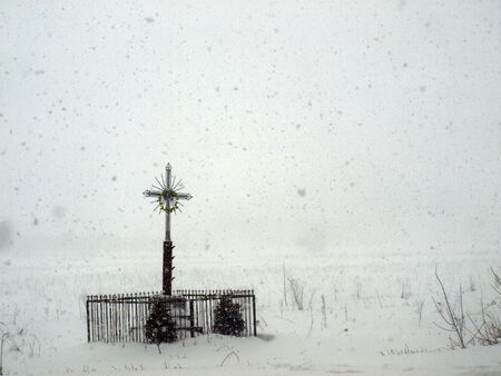 Traditional wayside shrine on a snowy countryside in Poland