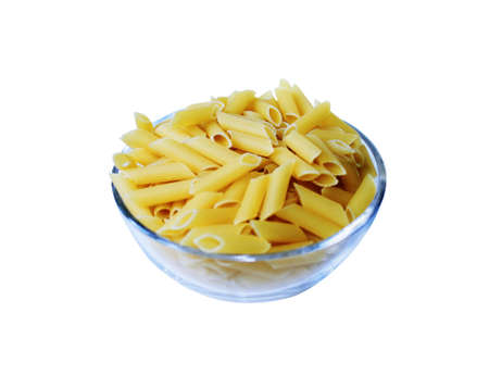 raw gold: raw pasta in a bowl isolated
