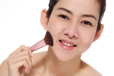 Beauty women asian make up brush on her face photo