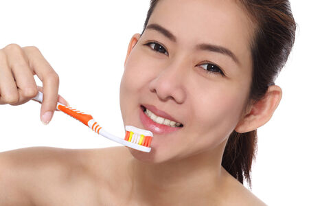 Beauty girl asian cleaning her teeth photo
