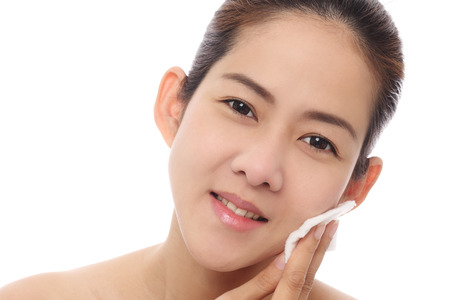 Beauty girl asian cleaning her face photo