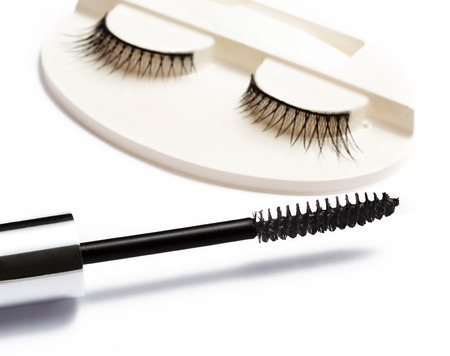 false eyelash set and mascara brush on white background  photo
