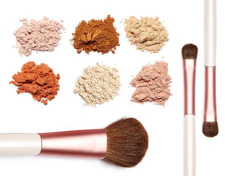 make up powder sweet color and brush on white background photo