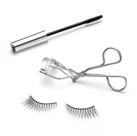 Fake false eyelash with eyelash curler and mascara Isolated on white background photo