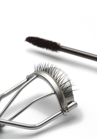 Eyelash curler with fake false eyelash and mascara Isolated on white background photo
