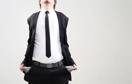 badly: businessman acting display that symbol of bankrupt