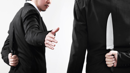 Competition is not a good friend. Businessmen should be prepared at all times isolated on white background photo
