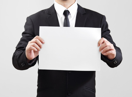 acting: Businessman acting show paper for something communicate Stock Photo