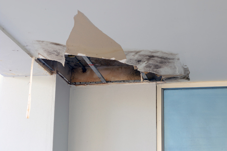 Ceiling panels damaged hole in roof office from drain pipes leakage.